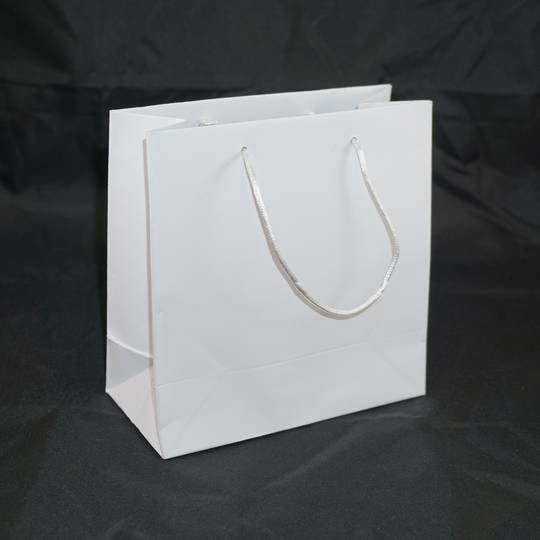 SMALL WHITE CARRY BAG WITH WHITE STRING HANDLES